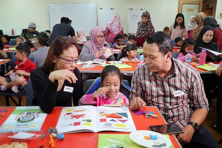 Ms Normaya Johari and Mr Muhd Faizal Jamil teaching their daughter Nayli Yusyairah Muhd Faizal, five, about shapes and colours yesterday. An initiative called KelasMateMatika@Pasir Ris East, which started on Sept 30, aims to equip children aged four