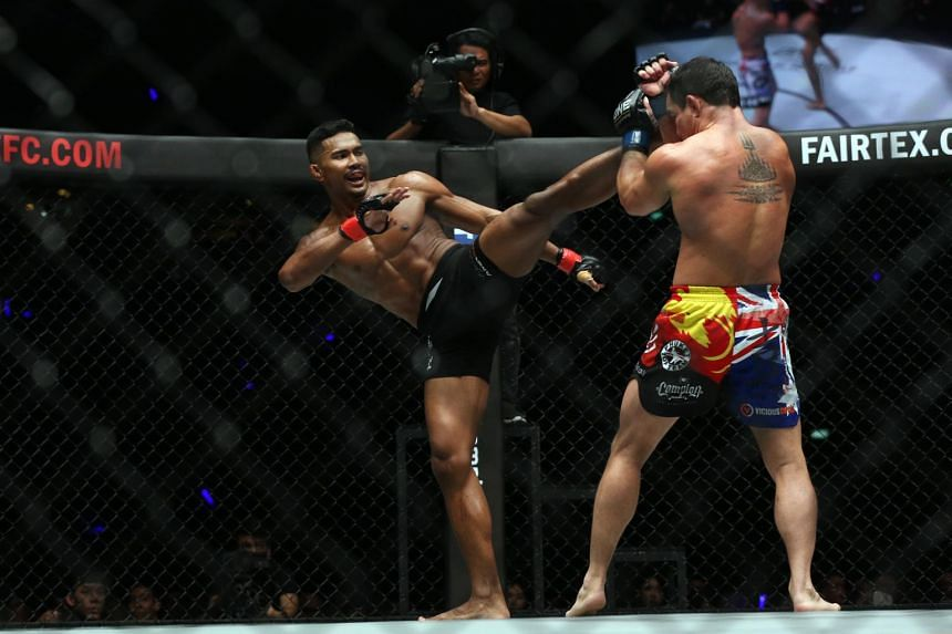 Singapore's Amir Khan landing a head kick on Australian Adrian Pang at One Championship's Immortal Pursuit, on Nov 24, 2017.