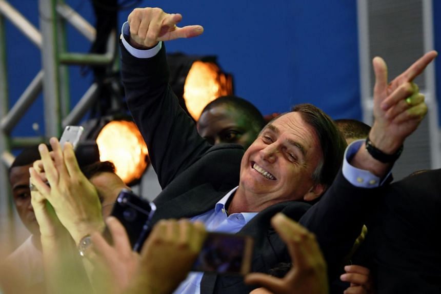 Mr Jair Bolsonaro is greeted by supporters as he launches his campaign for the Brazilian presidency in Rio de Janeiro, Brazil, on July 22, 2018.