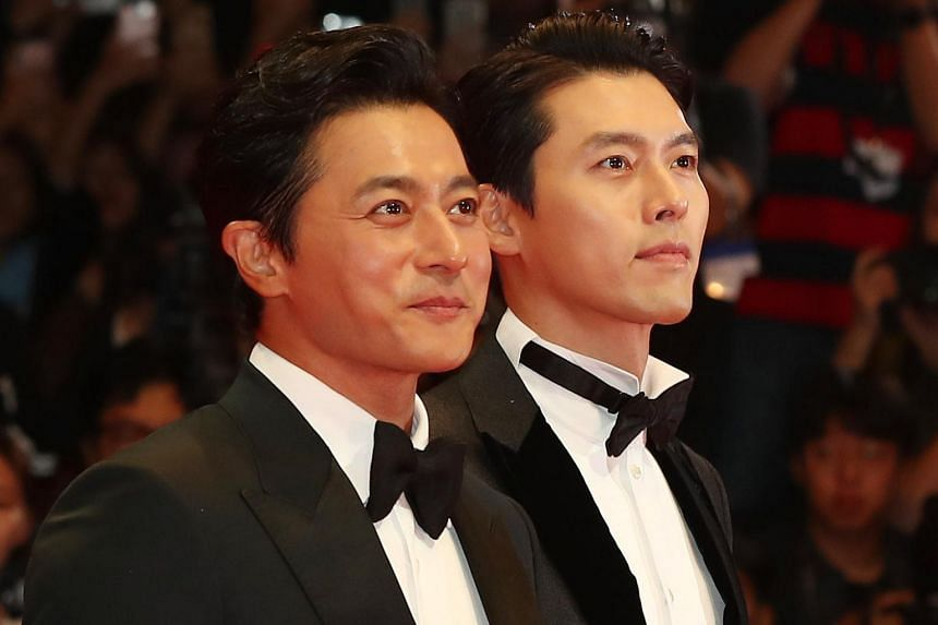 Actors Jang Dong-gun (left) and Hyun Bin on the red carpet at the opening ceremony of the 23rd Busan International Film Festival in Busan, South Korea, on Oct 4, 2018.