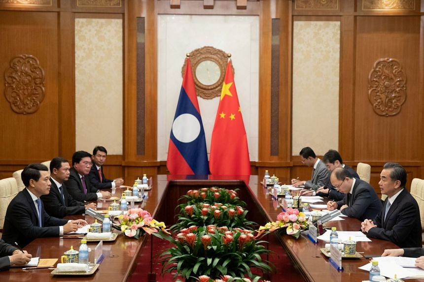 The flags of Laos and China seen during a meeting between officials of both countries at the Diaoyutai State Guesthouse in Beijing, China, on Aug 26, 2018.