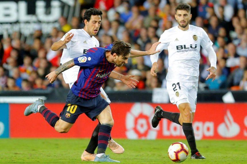 Barcelona's Lionel Messi in action with Valencia's Dani Parejo in Valencia, Spain, on Oct 7, 2018.