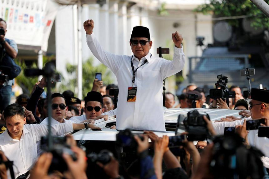 Prabowo Subianto gestures as he departs after registering himself as a candidate for the 2019 presidential election in Jakarta, on Aug 10, 2018.