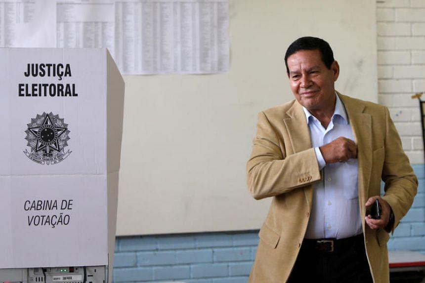 Hamilton Mourao, vice presidential candidate of Jair Bolsonaro, casts his vote in Brasilia, Brazil, on Oct 7, 2018.
