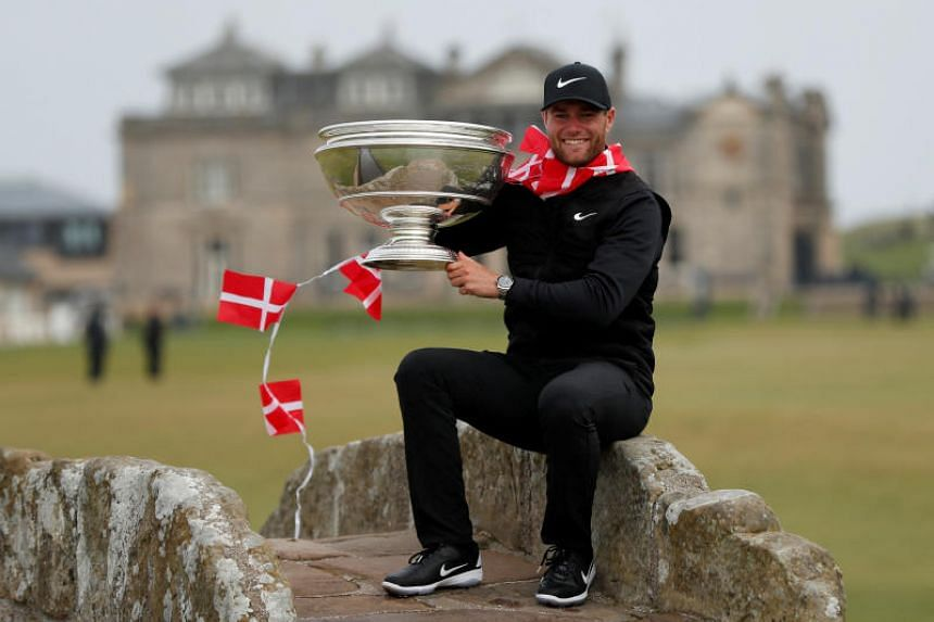 Lucas Bjerregaard celebrates with the trophy after winning the Alfred Dunhill Links Championship on Oct 7, 2018.