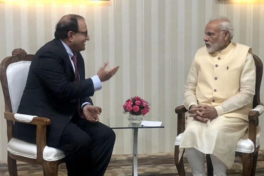 Singapore Minister-in-charge of Trade Relations S. Iswaran (left) with Indian Prime Minister Narendra Modi on Oct 7, 2018.