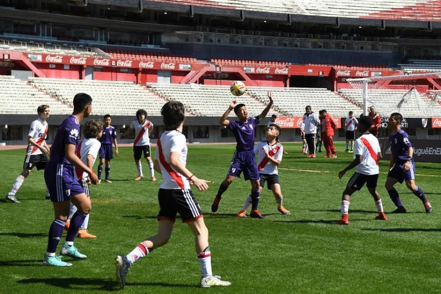 Young footballers of Thai team Wild Boars playing a football match against River Plate Youth Team at Monumental stadium, in Buenos Aires, on the sidelines of the Buenos Aires 2018 Youth Olympic Games on Oct 7, 2018.
