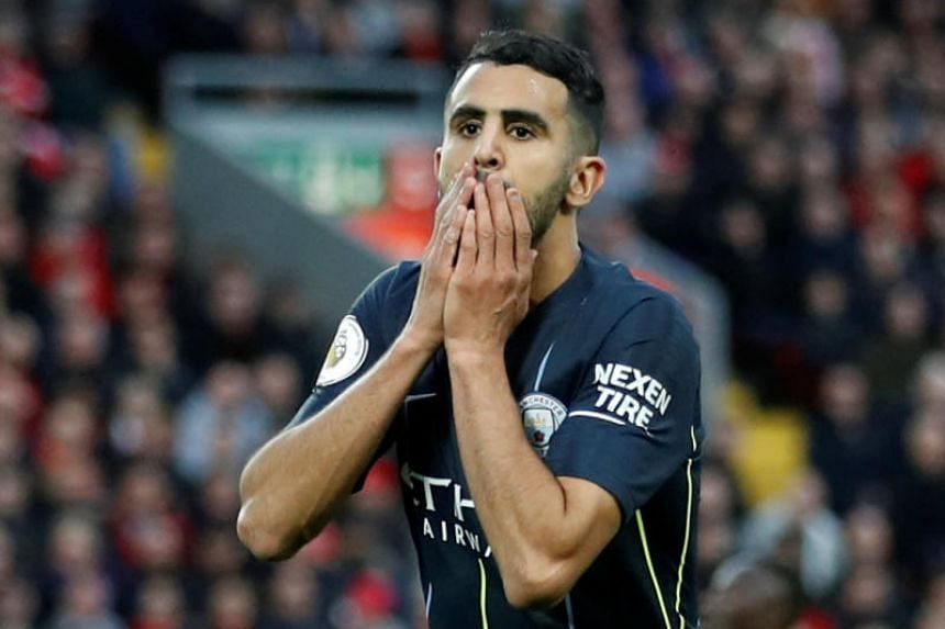 Manchester City's Riyad Mahrez reacts after a missed chance at Anfield, Liverpool, Britain, on Oct 7, 2018.