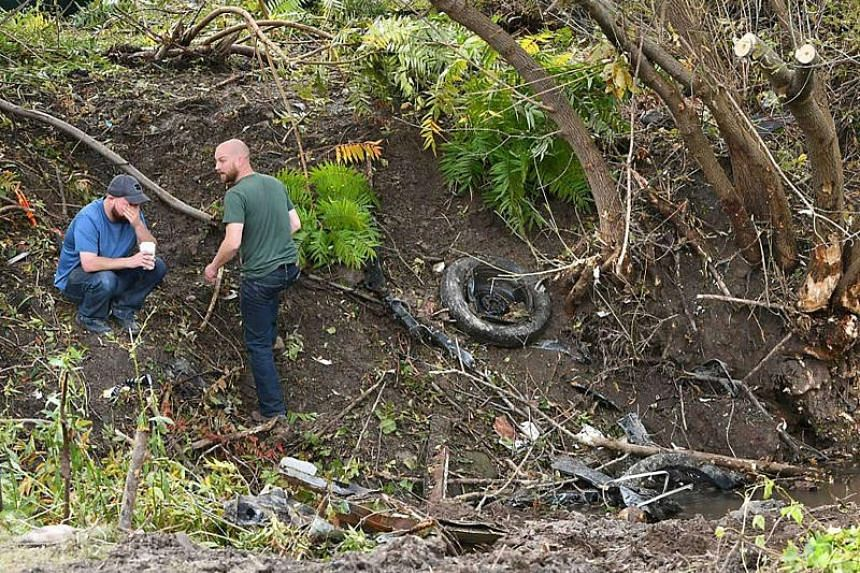 Distraught family members take in the scene in Schoharie, New York, on Oct 7, 2018, one day after an accident in Schoharie, New York, that left 20 people dead.