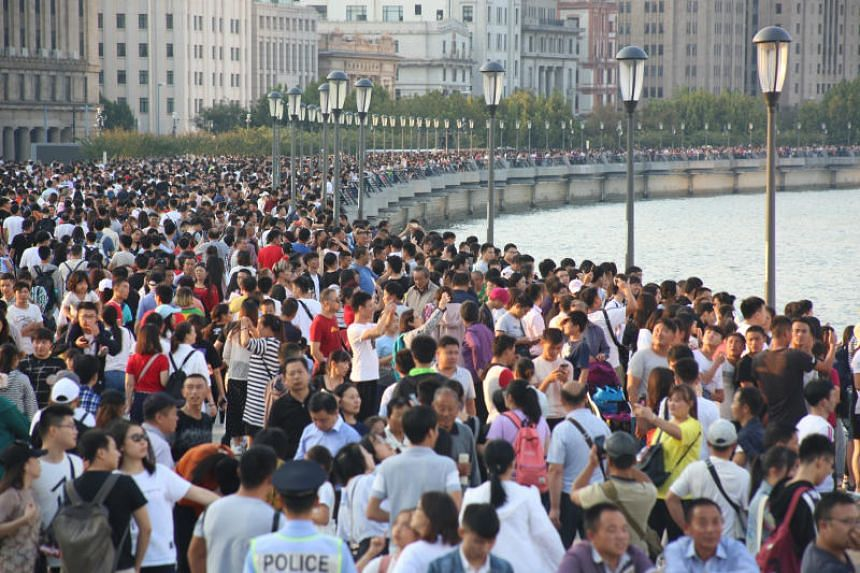Visitors throng the Bund in Shanghai on the second day of China's eight-day National Day holiday on Oct 2, 2018.