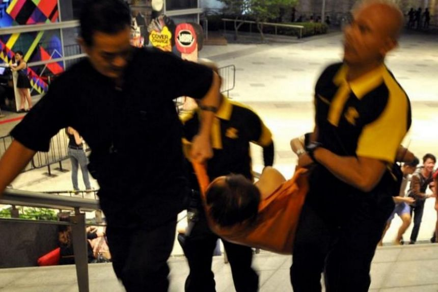 A drunk clubber being carried away on a stretcher after collapsing.