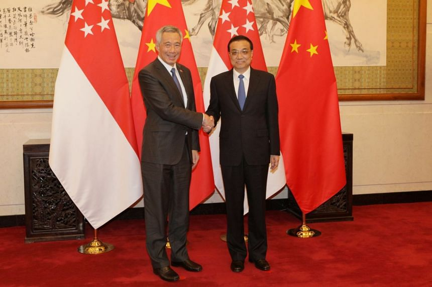 Chinese Premier Li Keqiang (right) greeting Prime Minister Lee Hsien Loong at the Diaoyutai State Guesthouse in Beijing, China, on April 8, 2018.
