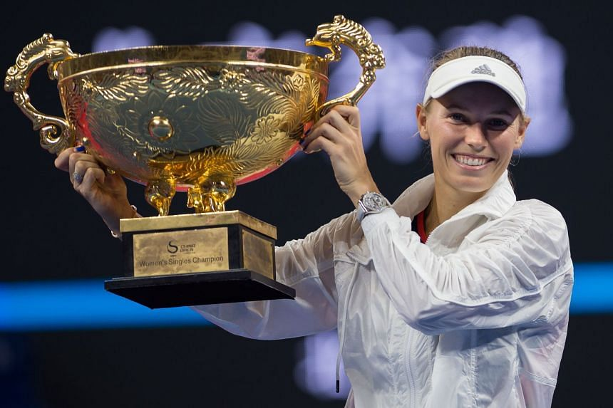 Caroline Wozniacki of Denmark with the trophy after winning the women's final against Anastasija Sevastova of Latvia at the China Open tennis tournament in Beijing on Oct 7, 2018.
