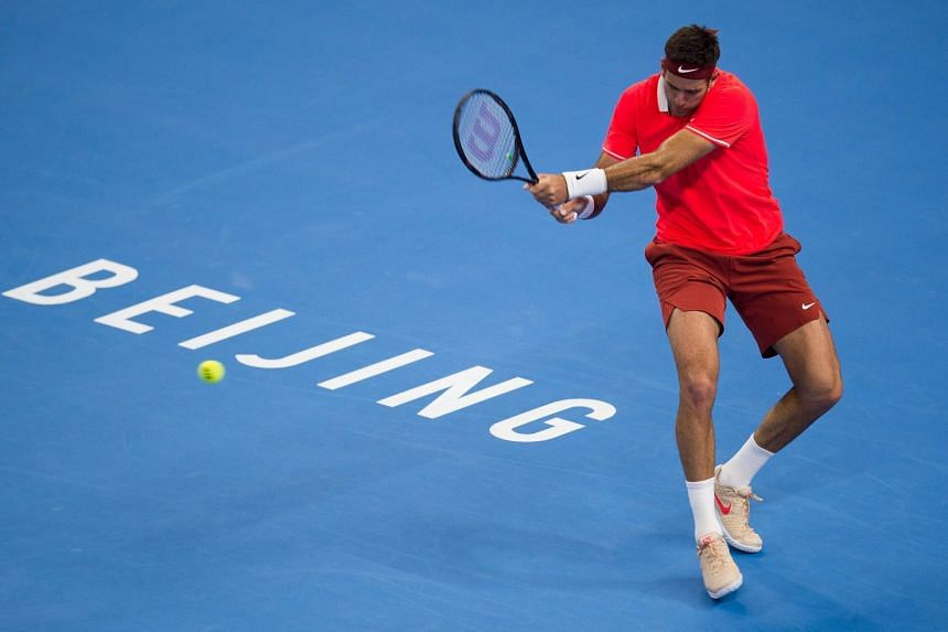 A far-from-fit Juan del Potro returning during his straight-sets loss to the unheralded Nikoloz Basilashvili in the China Open final in Beijing on Oct 7, 2018.