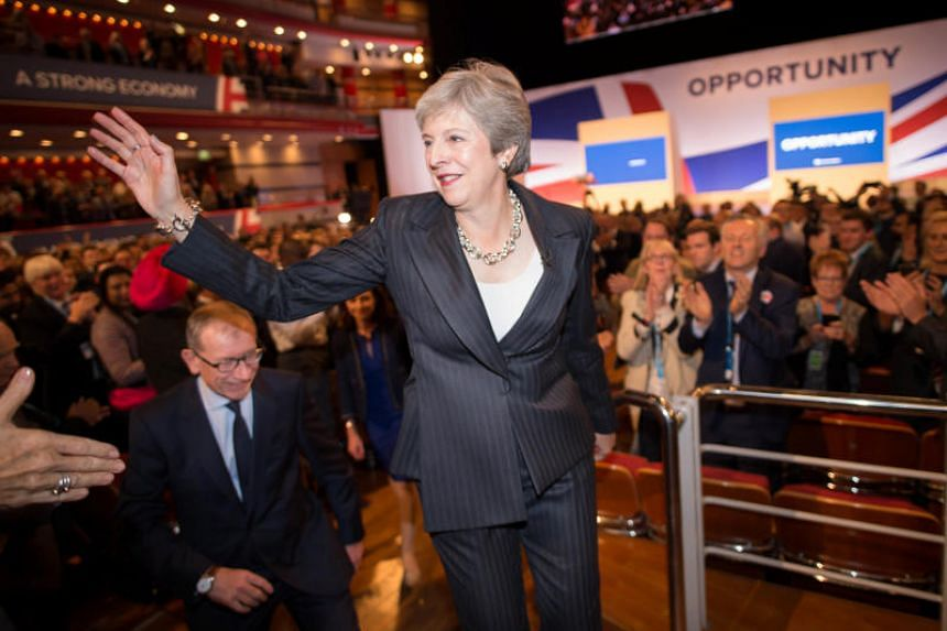 Britain's Prime Minister Theresa May greeting supporters after her speech at the Conservative Party conference at the International Convention Centre, Birmingham, Britain, on Oct 3, 2018.