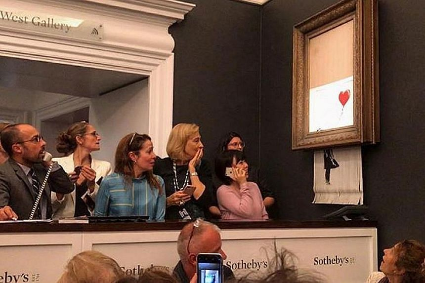 The video of the artwork, Girl With Balloon, being shredded was posted on Banksy's Instagram page last Saturday.