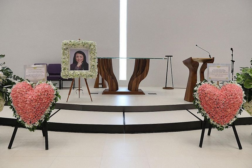 Two heart-shaped wreaths were placed near Dawn Gan's picture by her family at the service yesterday. She died of cancer on Sept 22.