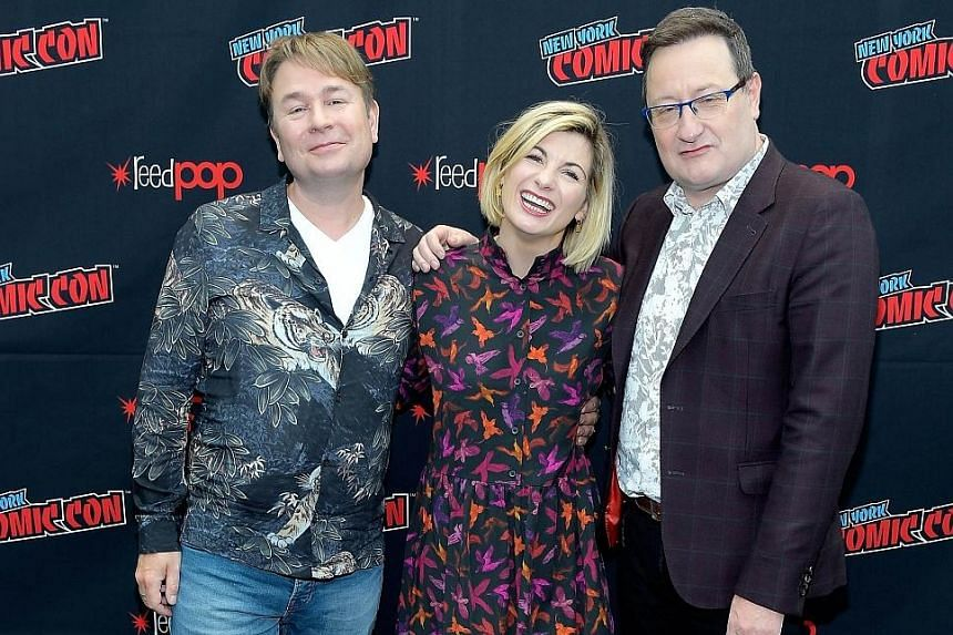 Dr Who producers Matt Strevens (far left) and Chris Chibnall with the star of the 11th season of Doctor Who, English actress Jodie Whittaker, at the New York Comic Con on Sunday.