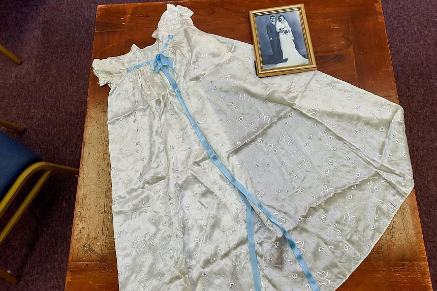 A baby's christening robe made from the train of Ms Lydwina Fernandez' 1949 bridal gown and a photo of her and her bridegroom, Mr Maurice Alban Cordeiro A tea set on loan from Mr Cedric Pereira. Tea time with cakes and sandwiches used to be a ritual