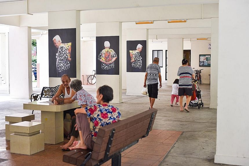 Public art installation, Kindling (above), comprising portraits of senior residents in Chong Pang, is part of a series of workshops under the Both Sides, Now project to engage the community on end-of-life issues.