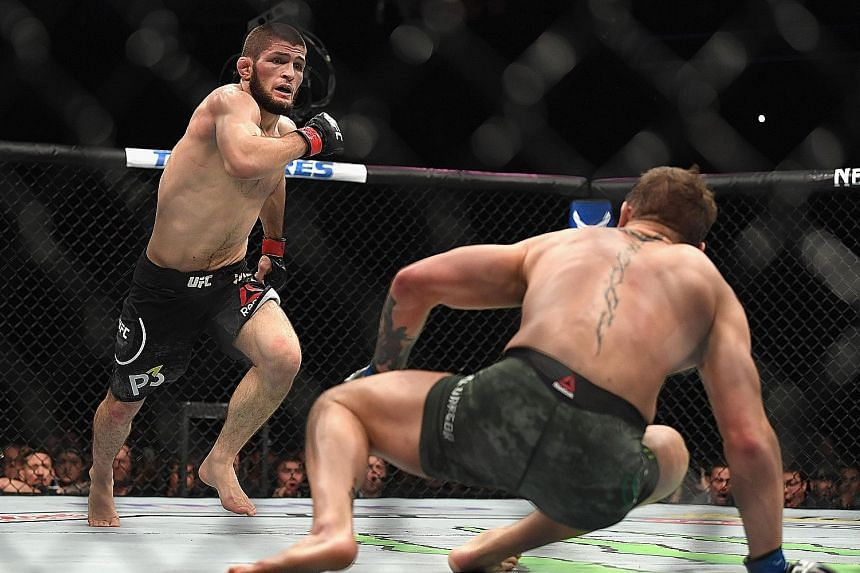 The UFC lightweight championship bout between Khabib Nurmagomedov (left) and Conor McGregor on Saturday night was marred by a post-fight brawl during which the latter was hit from behind by the Russian's sparring partner Zubaira Tukhugov. Featherweig