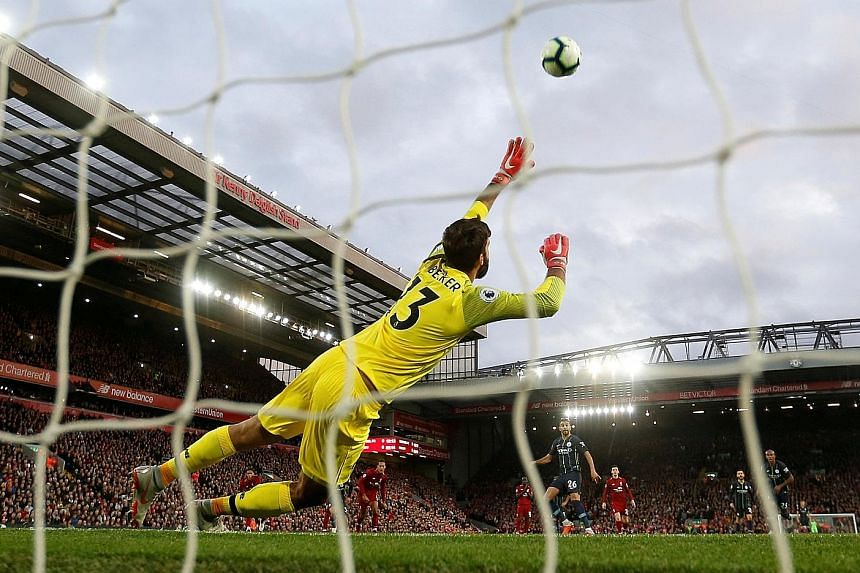 Riyad Mahrez skies his 85th-minute penalty over Liverpool custodian Alisson's goal as Manchester City waste a gilt-edged chance to get their first win at Anfield since 2003. City manager Pep Guardiola admitted he had erred in plumping for Mahrez to t