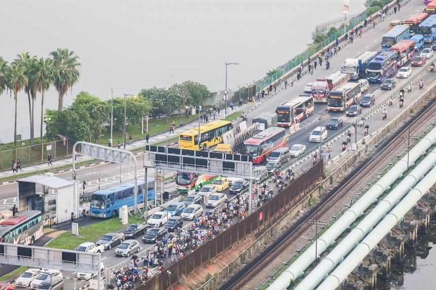 File photo of Woodlands Checkpoint. The Straits Times understands that the victim had skidded and hit a barricade at the arrival area just before immigration clearance for motorcycles.