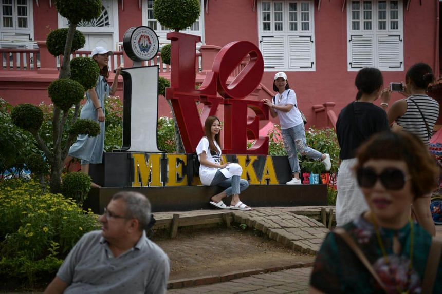 """People taking photos at a tourist attraction in Melaka, on Sept 11, 2018. China's """"golden week"""" last year saw about 180,000 Chinese tourists coming to Malaysia."""