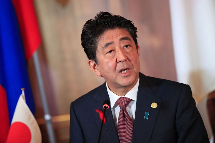 Japanese Prime Minister Shinzo Abe delivers a speech at the 10th Mekong-Japan Summit in Tokyo on Oct 9, 2018.
