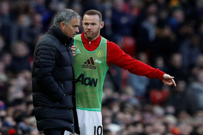 Former Manchester United striker Wayne Rooney (right) threw his support behind manager Jose Mourinho after widespread media speculation about the latter's future at the club.