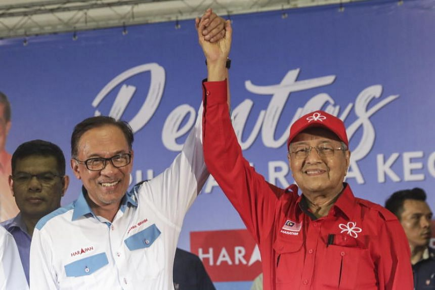 Malaysia Prime Minister Mahathir Mohamad (right) and prime minister-in-waiting Anwar Ibrahim during a campaign ahead of by-election in Port Dickson, Malaysia, on Sept 9, 2018.