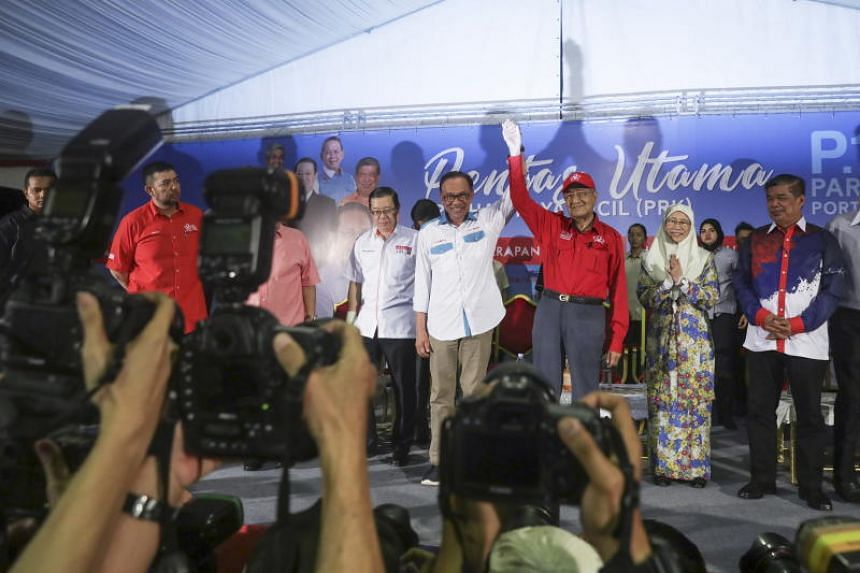 Malaysia's Prime Minister Mahathir Mohamad (right) and Anwar Ibrahim appeared together at a political rally for the  first time in 20 years, where the latter is contesting in the Port Dickson by-election to return to Parliament.