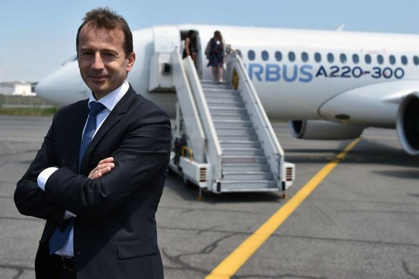 Guillaume Faury, then President of the Airbus Commercial Aircraft poses in front of the new Airbus A220-300 during its presentation at the Airbus delivery center, in Colomiers, southwestern France, on July 10, 2018.