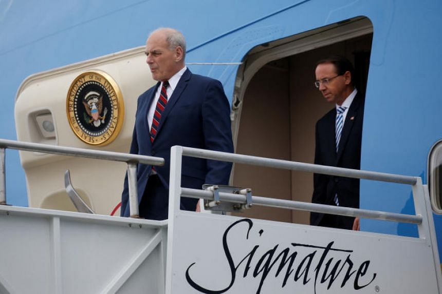 US Deputy Attorney General Rod Rosenstein follows White House Chief of Staff John Kelly out of Air Force One as they arrive with President Trump in Orlando, Florida, US, on Oct 8, 2018.