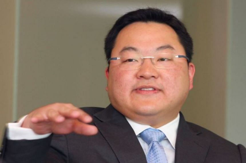 """Council of Eminent Persons chairman Daim Zainuddin said """"moles"""" in the government fed information that allowed fugitive businessman Jho Low (pictured) to evade capture."""