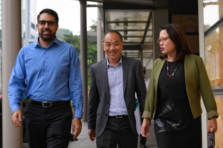 Workers' Party MPs Pritam Singh, Low Thia Khiang and Sylvia Lim outside the Supreme Court on Oct 9, the third day of a multimillion-dollar trial.