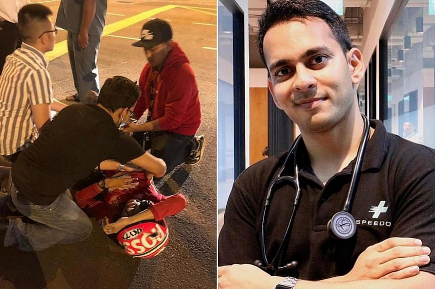 Dr Shravan Verma (in black shirt), a nurse and other passers-by rendered aid to a man who was lying on the road near Lau Pa Sat on Sunday night (Oct 7).
