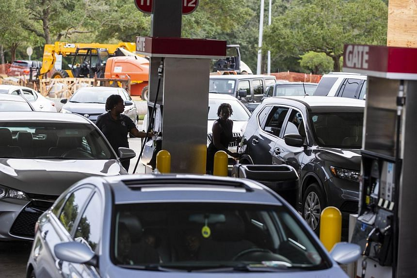 Drivers line up for gasoline as Hurricane Michael bears down on the northern Gulf coast of Florida on Oct 8, 2018 in Tallahassee, Florida.