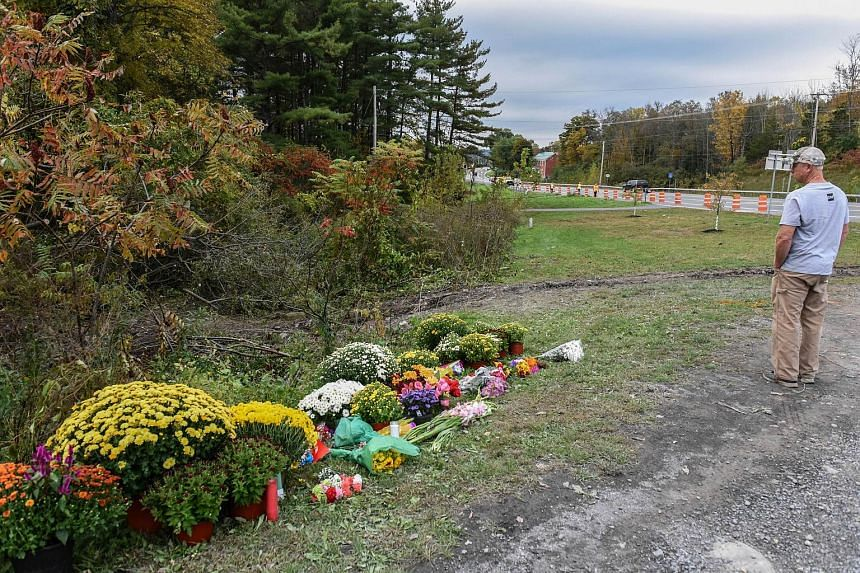A mourner looks on at the site of the fatal limousine crash on Oct 8, 2018, in Schoharie, New York.