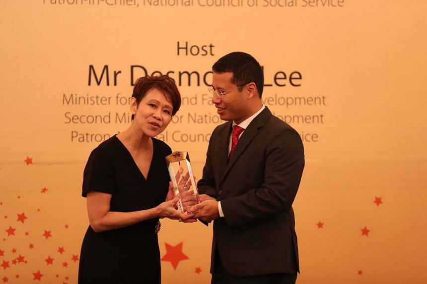 Ms Susan Ng, 62, received the Enabler Award from Mr Desmond Lee, Minister for Social and Family Development and Patron of the National Council of Social Service at the Istana during the Community Chest Awards 2018.