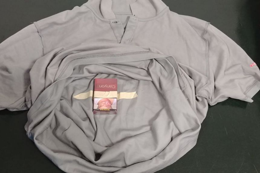 One packet of duty-unpaid cigarettes was found hidden inside a shirt belonging to a 56-year-old Malaysian work permit holder.