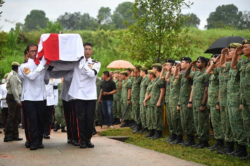 Singapore Armed Forces personnel saluting as Muhammad Sadikin Hasban's coffin is being carried to the burial site on Oct 10, 2018.