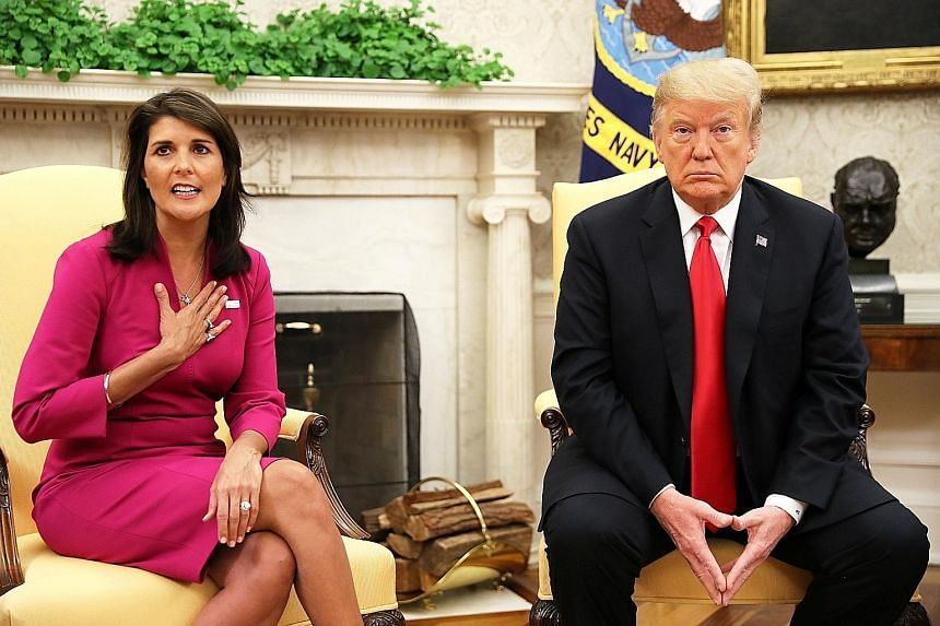 Ms Nikki Haley with US President Donald Trump in the Oval Office yesterday. Ms Haley took the UN envoy job with little experience in foreign policy but quickly became the full-throated voice at the UN for the often unpopular agenda of Mr Trump.