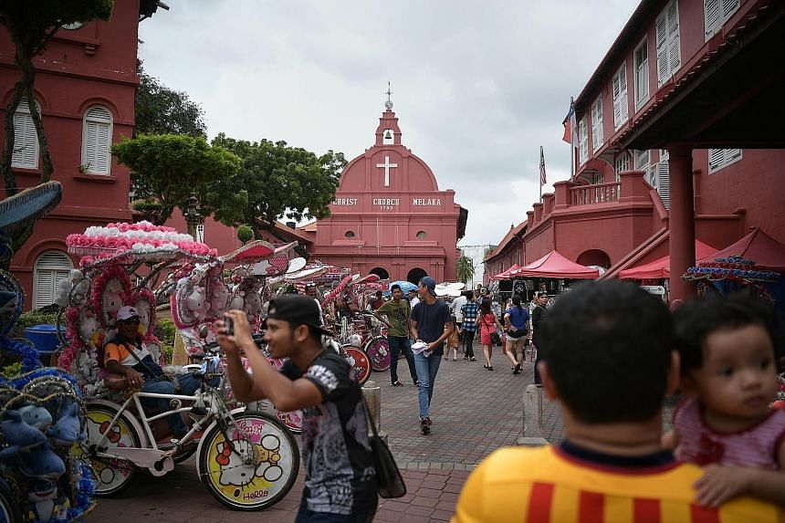 Many trishaws in Melaka are decorated with characters from cartoons and movies and blare out Western songs, at odds with the identity of the Unesco World Heritage site.