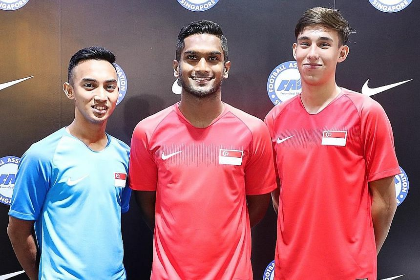 From left: Faris Ramli, new captain Hariss Harun and Jacob Mahler at the launch of the new Lions jersey at Weston Corporation in Kallang Wave Mall yesterday. Singapore will play friendlies against Mongolia and Cambodia on Friday and next Tuesday resp