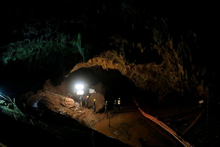 Rescue workers at the Tham Luang cave complex in Thailand on, July 10, 2018, the day the 12 boys were rescued.