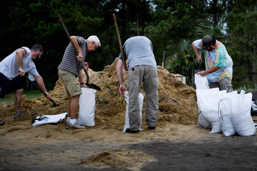 People filling bags with sand, in preparation for Hurricane Michael, at the Lynn Haven Sports Complex on Oct 9, 2018 in Panama City, Florida.