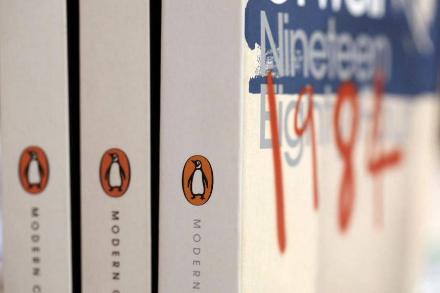 Copies of Nineteen Eighty-four by George Orwell, published by the Penguin publishing house, are displayed at a bookstore in London, on April 5, 2013.