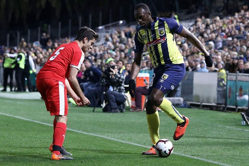 Usain Bolt (right), playing for A-League football club Central Coast Mariners, fights for the ball during a pre-season practice football match in Gosford, New South Wales, on Aug 31, 2018.