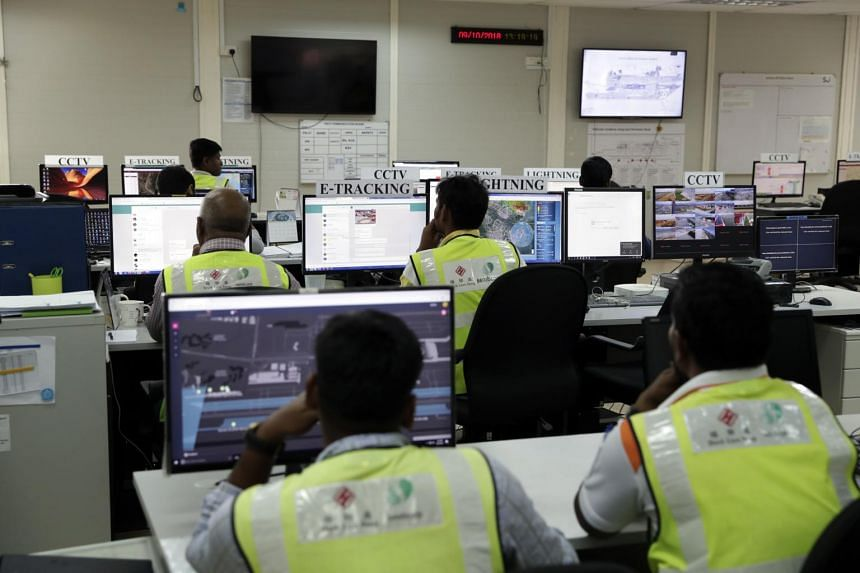 Staff at their workstations in the Changi East construction site command centre on Oct 9, 2018. About 20,000 workers will be based at the site by 2020.